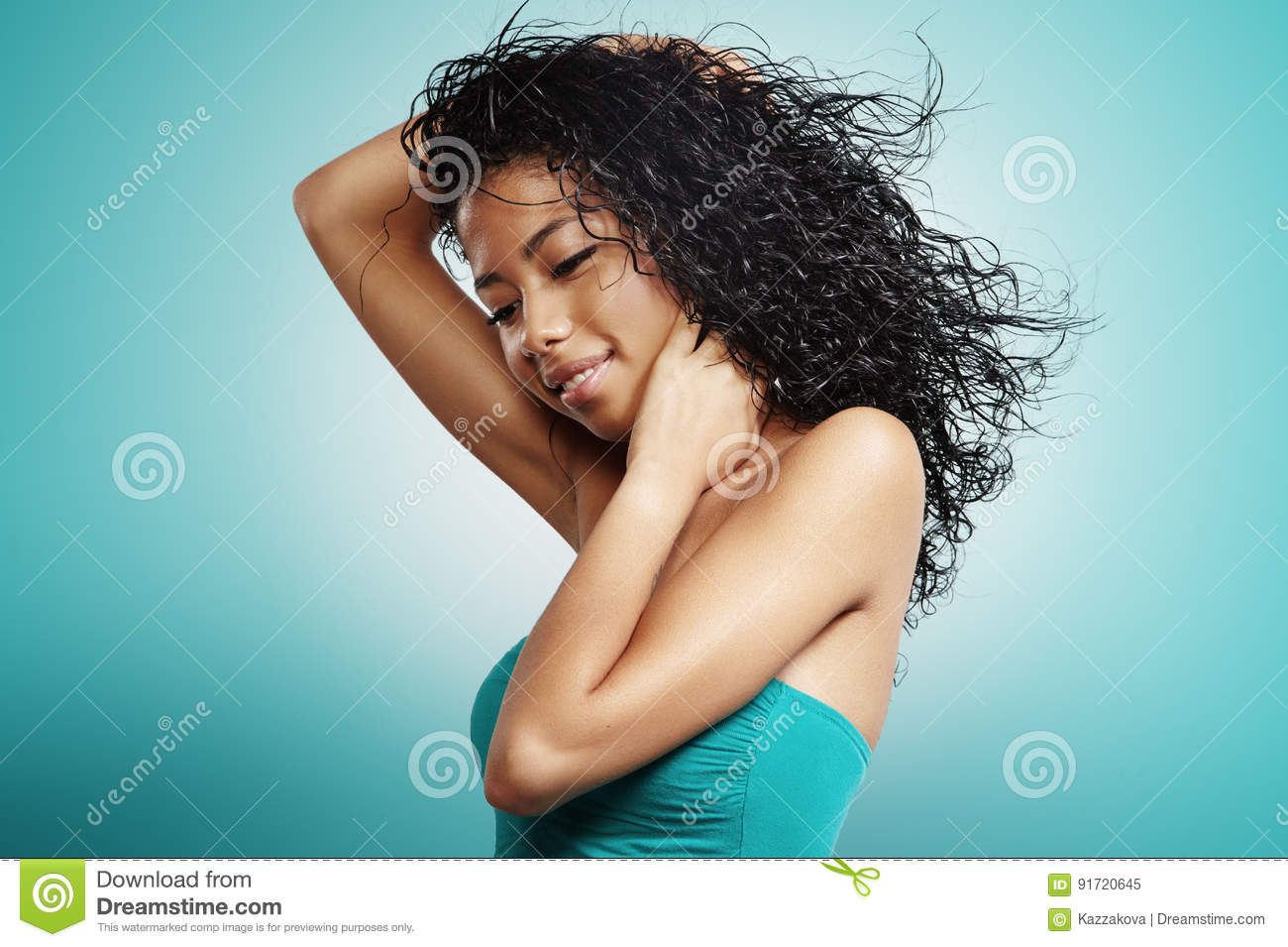 Black woman with curly hair and flying hair