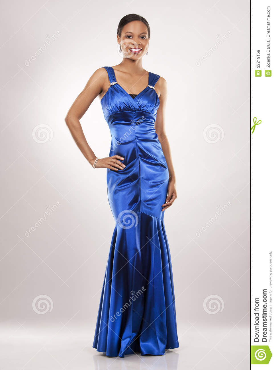 Luxury Pretty Black Woman In Blue Dress Looking Thoughtful With A Yellow
