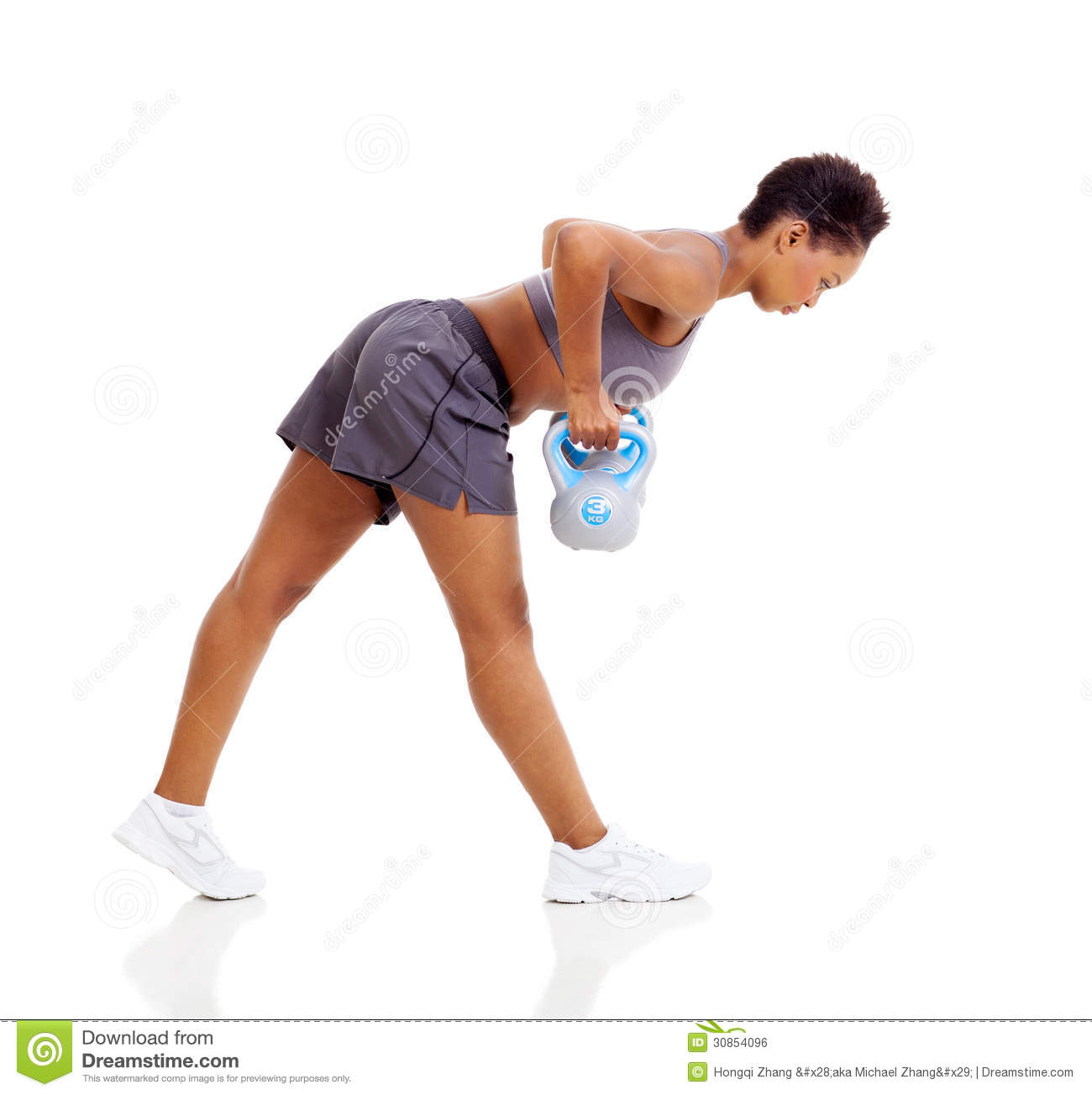 Young black woman doing kettle bell weight exercise over white ...