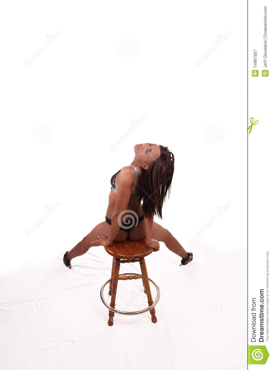 Black Woman In Lingerie On Stool From Back Royalty Free