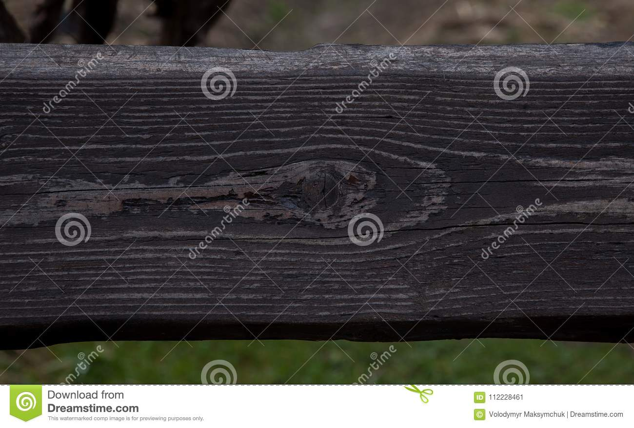 Black wooden abstract background with light and scratches, dark wood texture