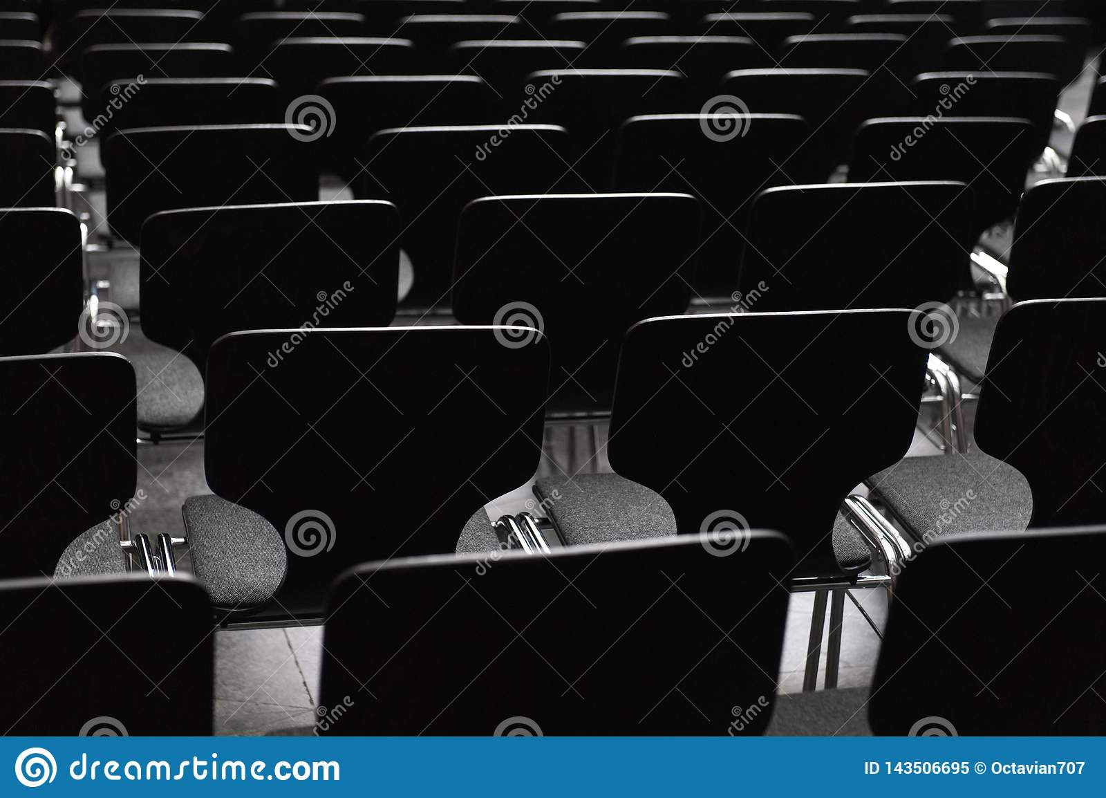 Black wooden chairs in rows