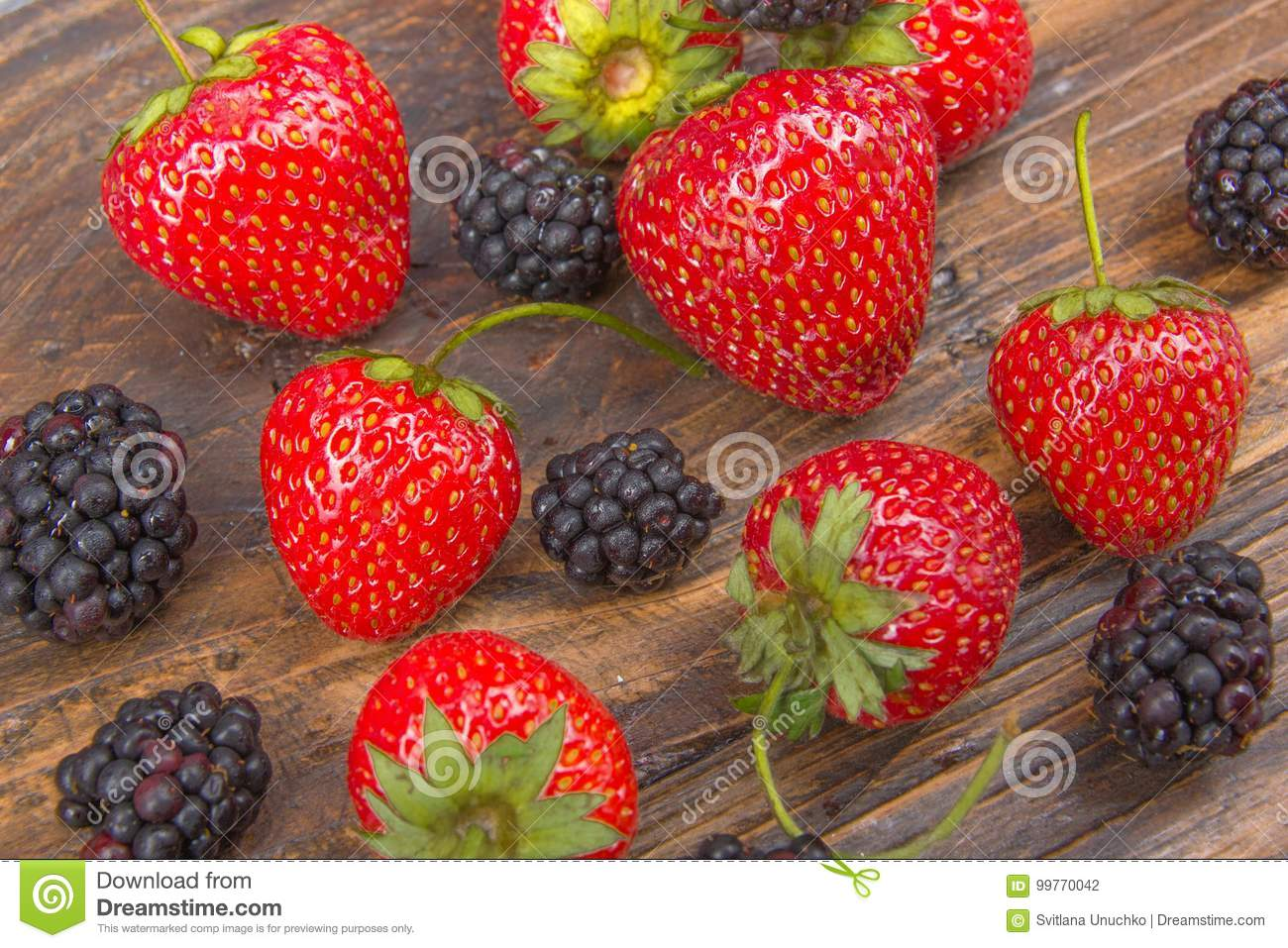 Blackberries Strawberrieson Wooden Table Background Spilled From A Spice Jar Antioxidants Detox Diet Organic Fruits
