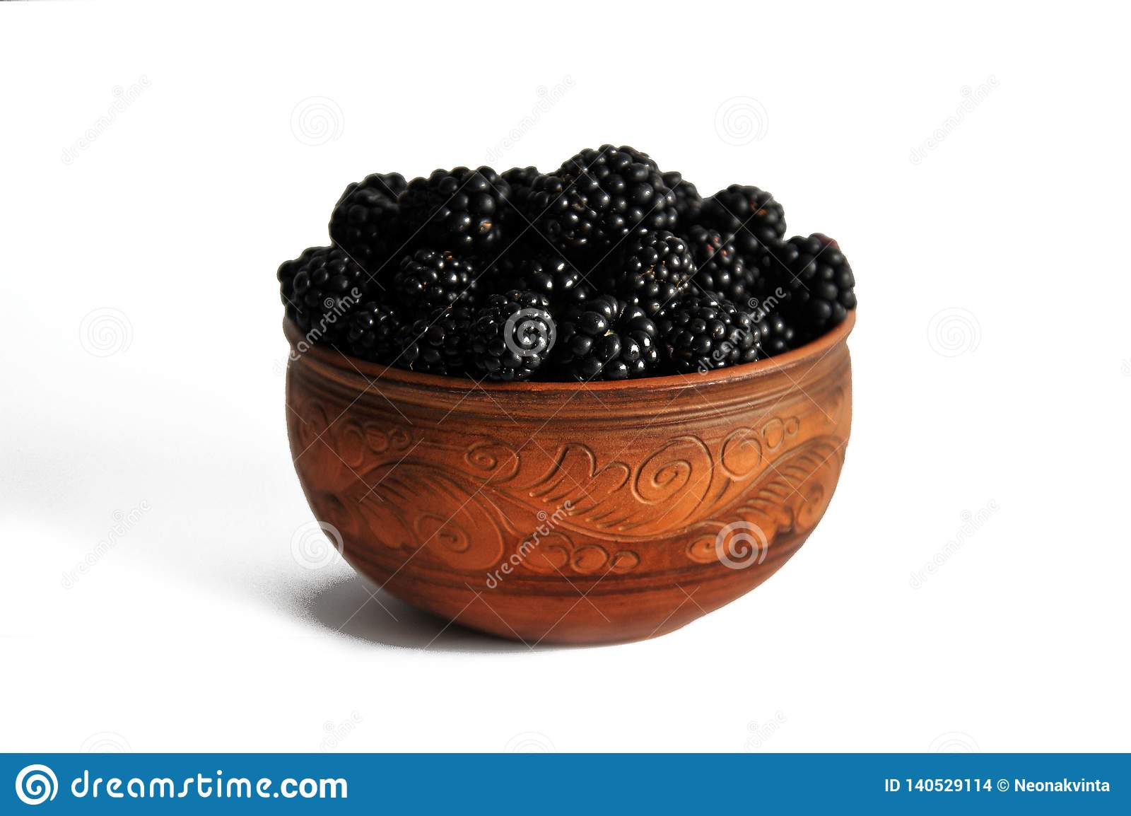 Blackberry berries in pottery isolated on white