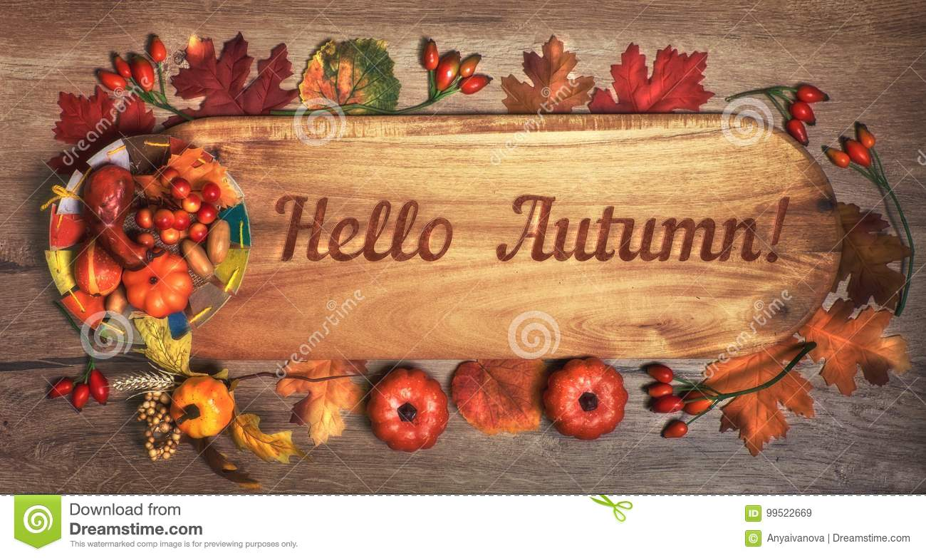 Blackboard with text `Hello Autumn`with Fall decorations