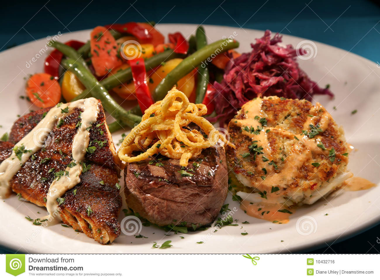 blackened fish  filet mignon steak  crab cakes and royalty free stock image
