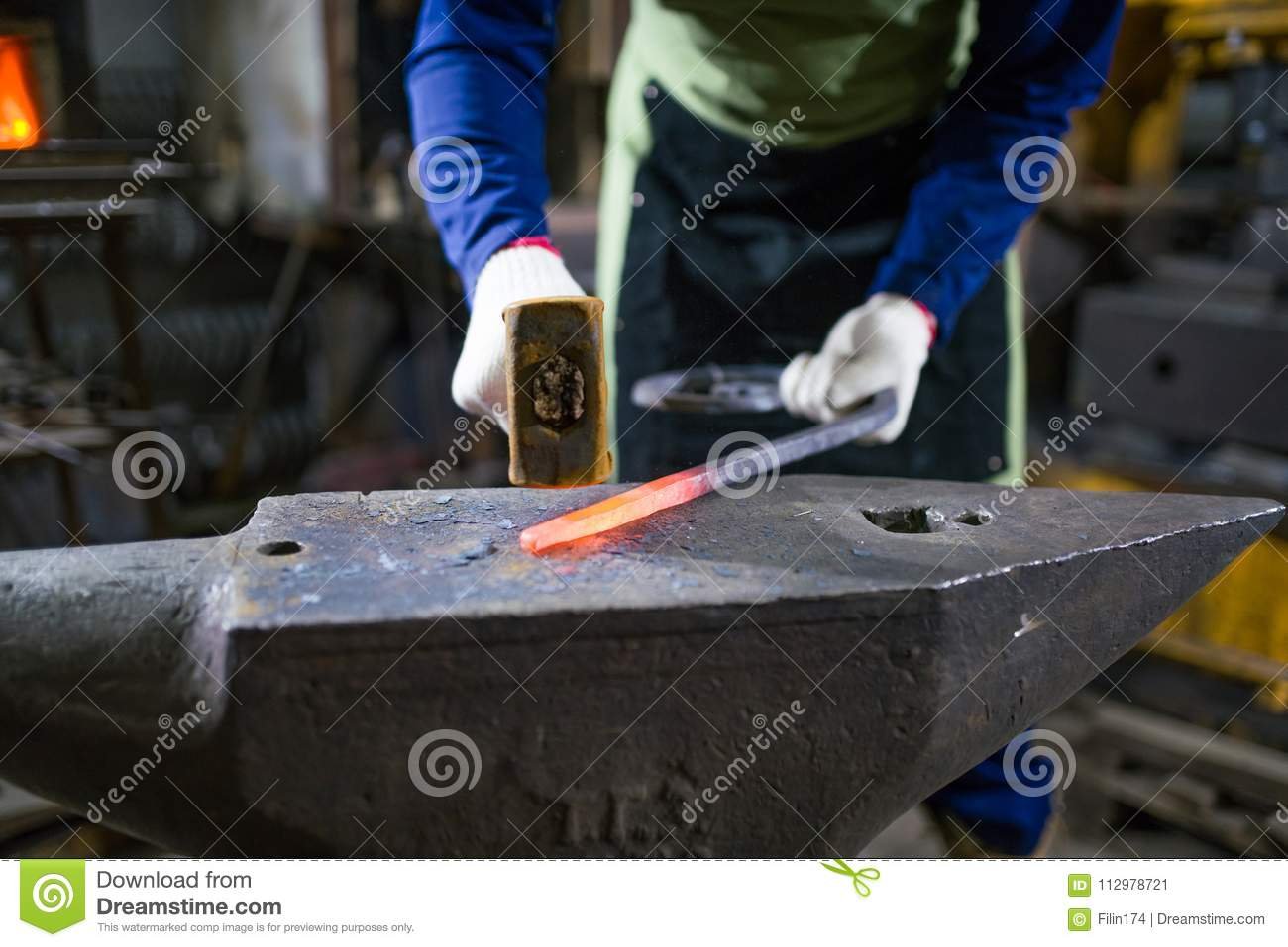 The blacksmith forges the luminous metal in the furnace, kicks out the sparks