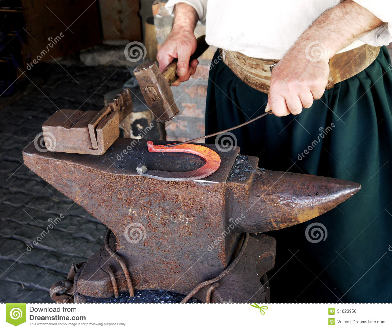 blacksmith making horseshoes royalty free stock image