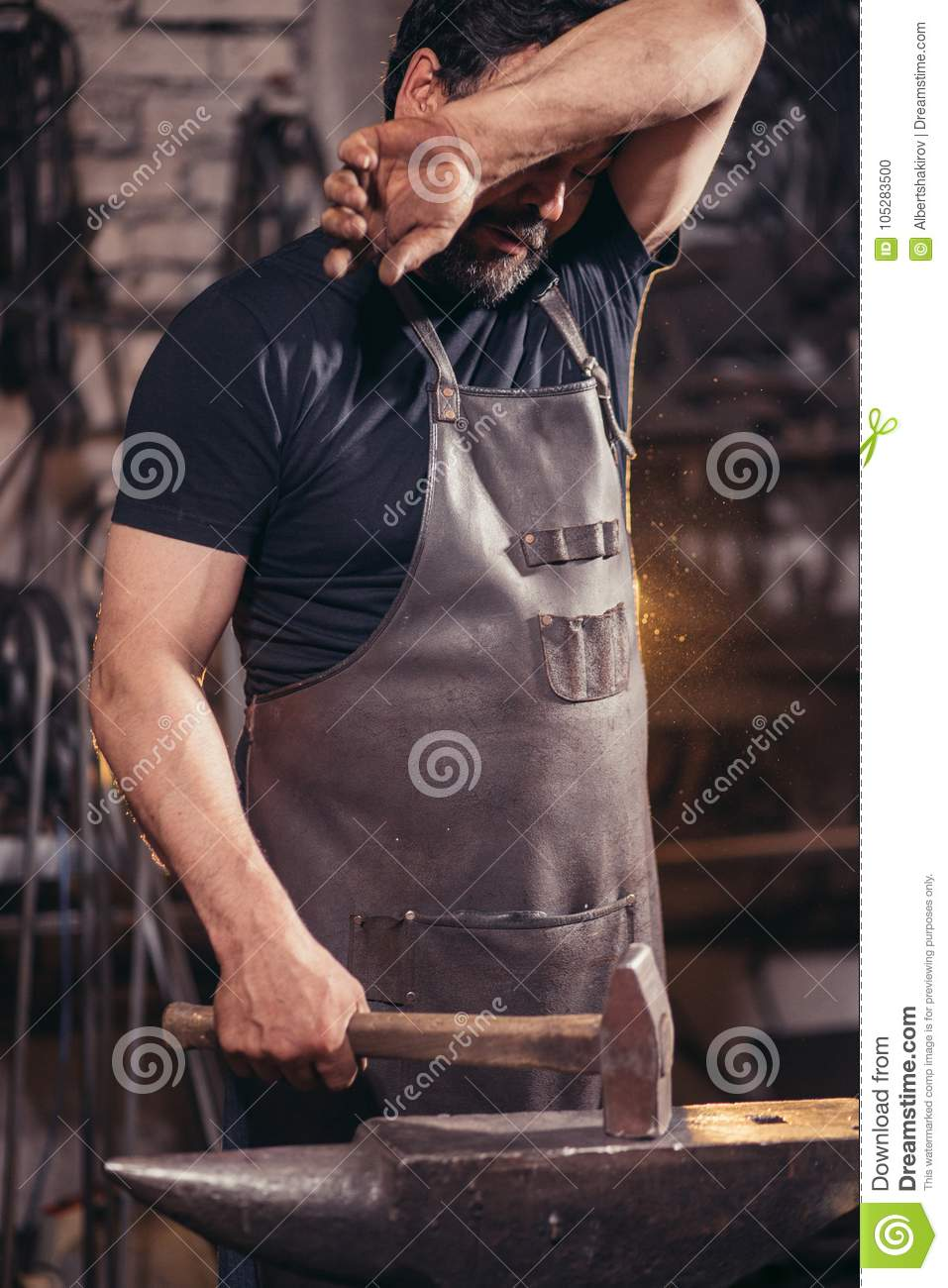 Blacksmith Wipe Sweat In Workshop Stock Photo - Image of