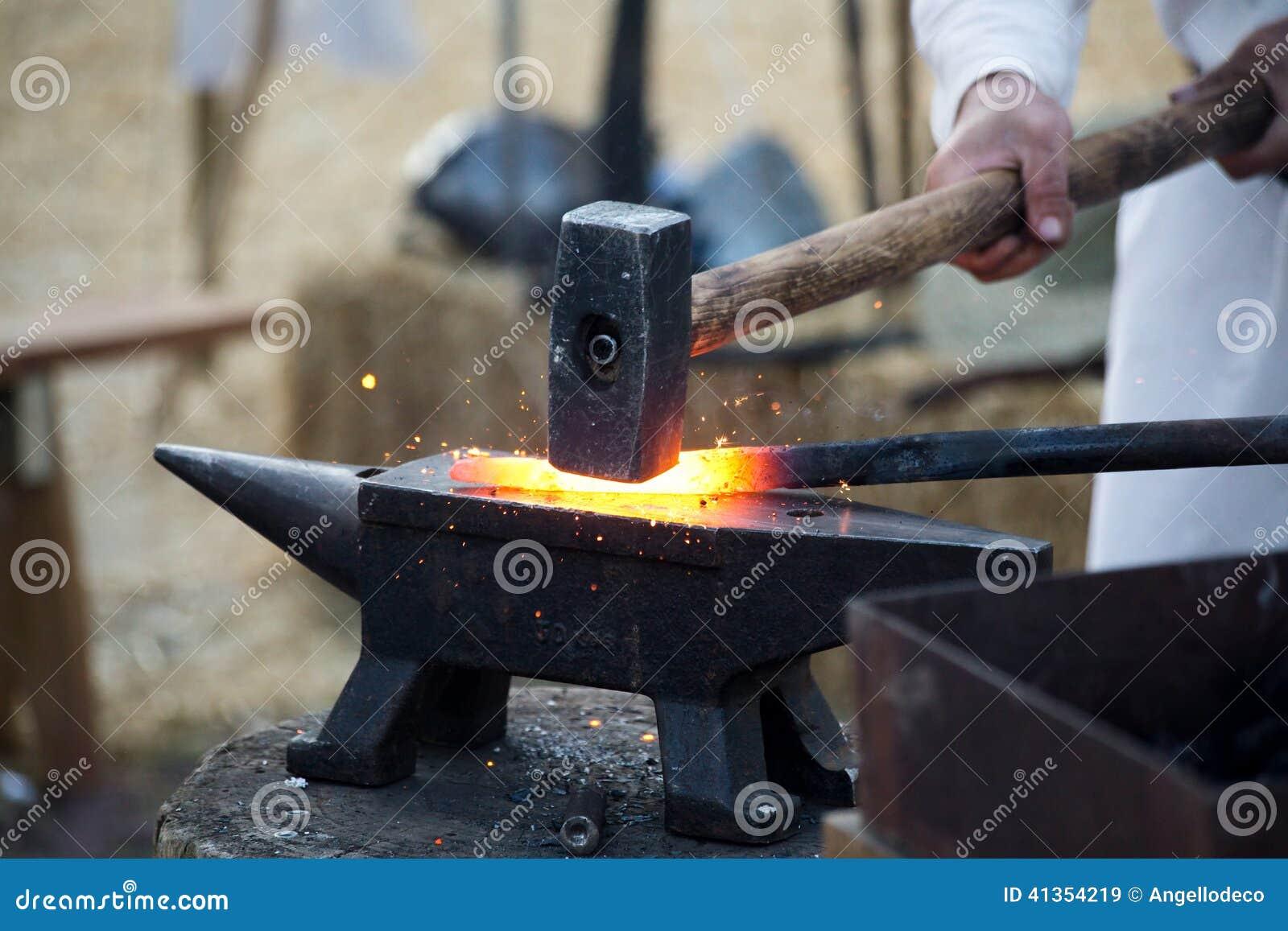 Blacksmith Working Hot Iron Stock Photo - Image: 41354219