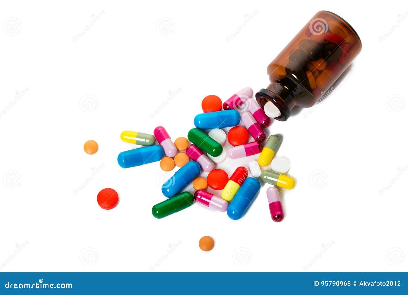 Blandade farmaceutiska medicinpreventivpillerar, minnestavlor och kapslar över svart bakgrund