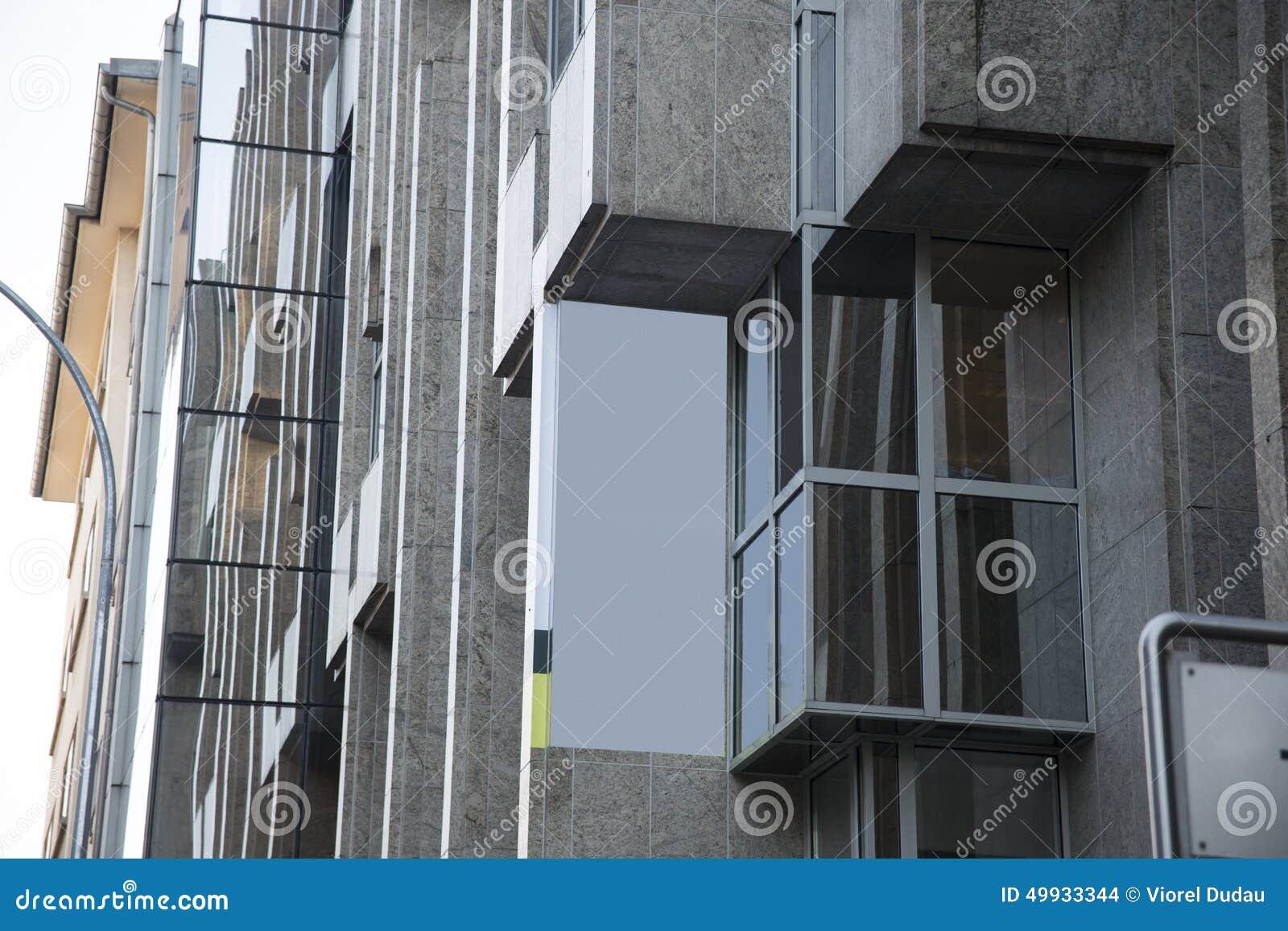 Blank advertising banner on block building