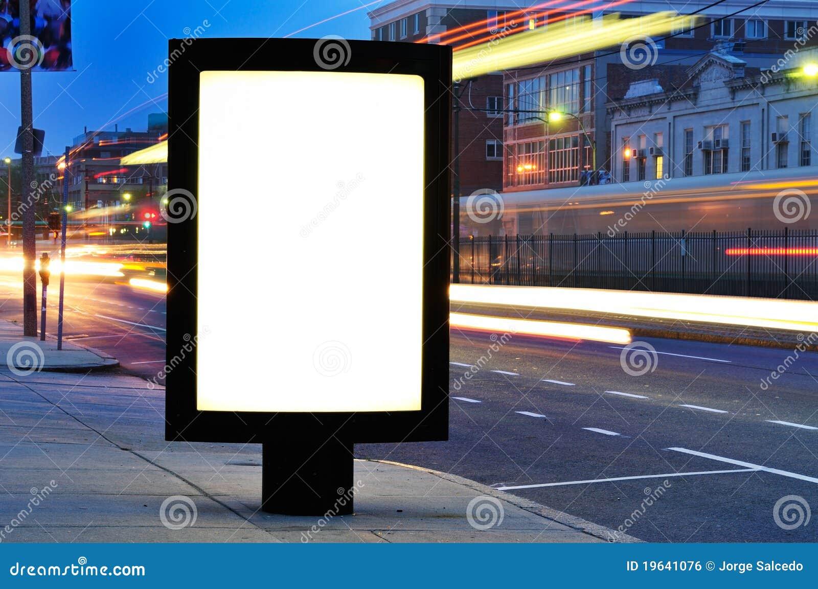 Blank Billboard On City Street At Night Stock Photo