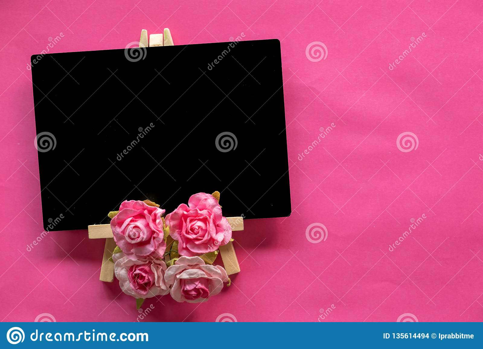blank blackboard and pink flower on pink background with copy space, Valentines Day concept