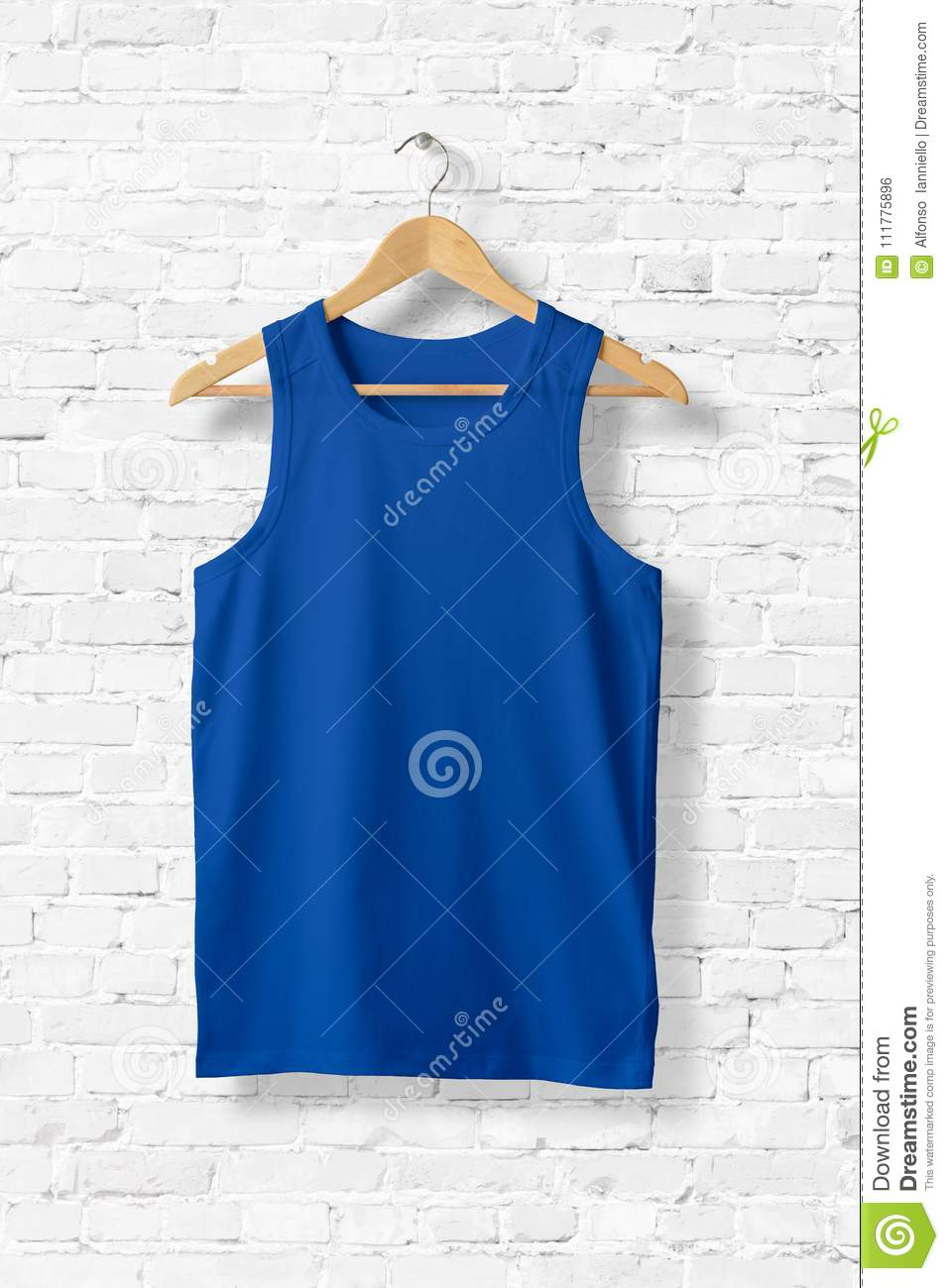 Blank Blue Tank Top Mock-up hanging on white wall.