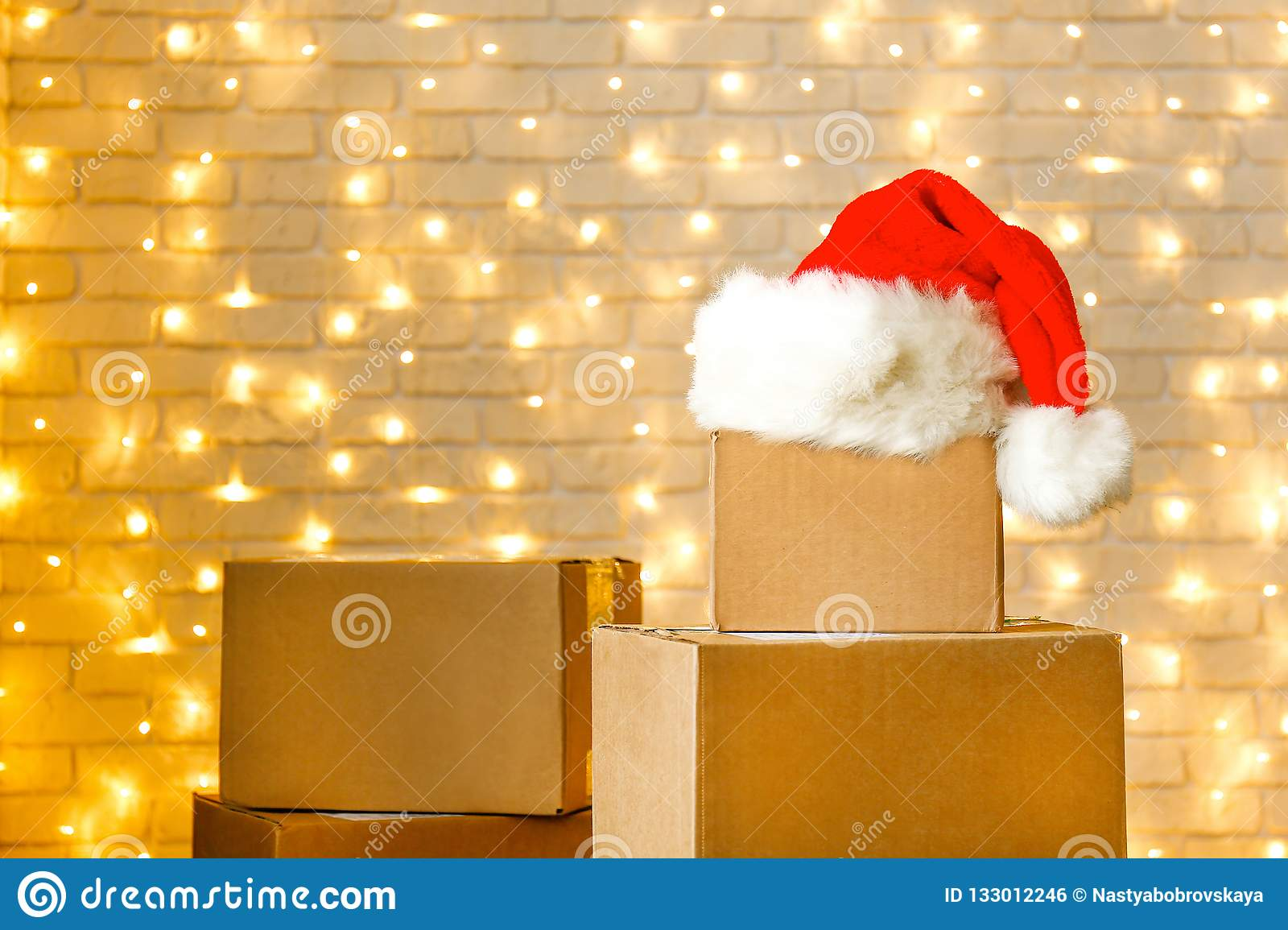 6af740b16 Corrugated Fiberboard Boxes With Christmas Lights On Background ...