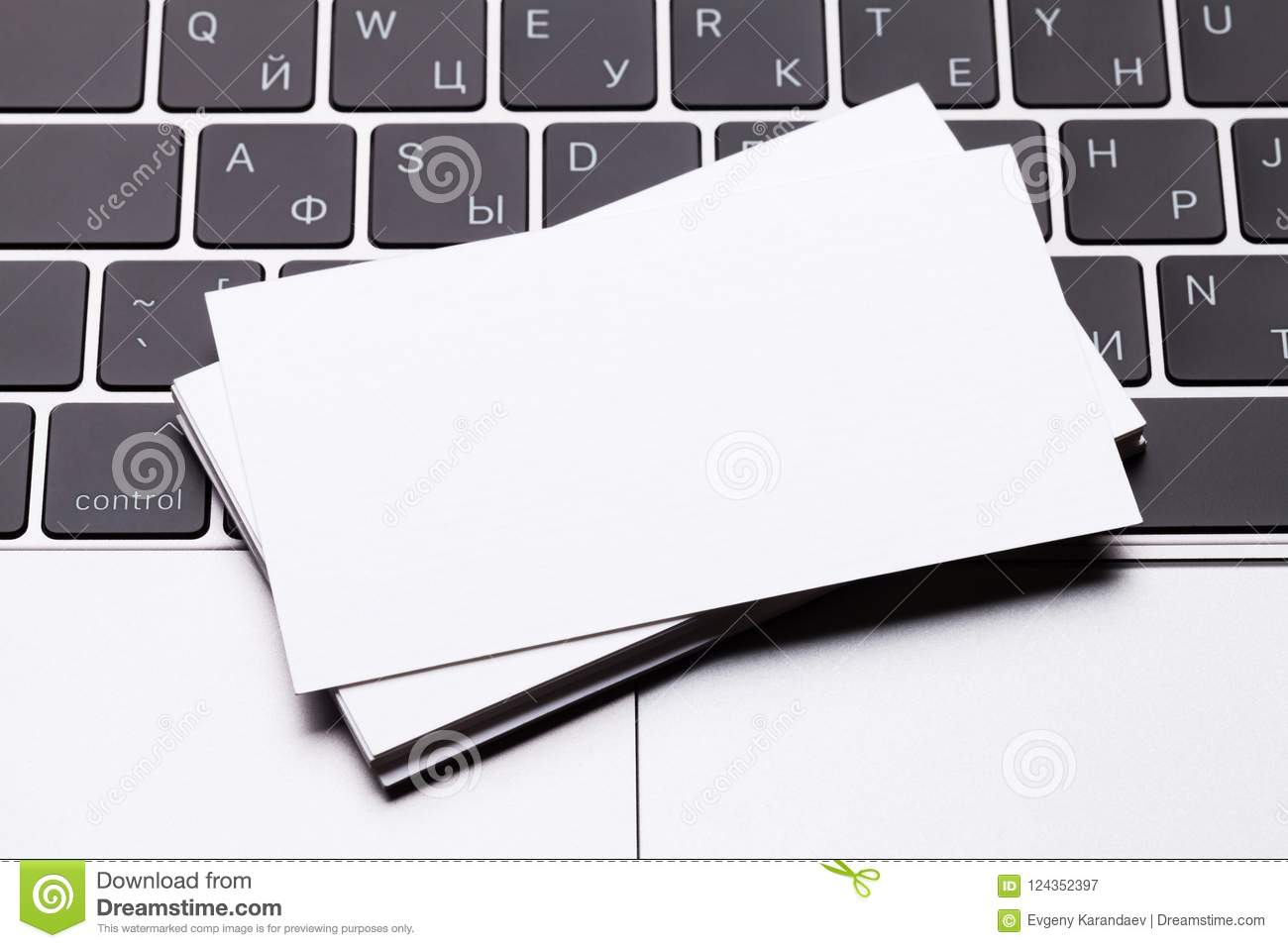 blank business cards over laptop keyboard stock image
