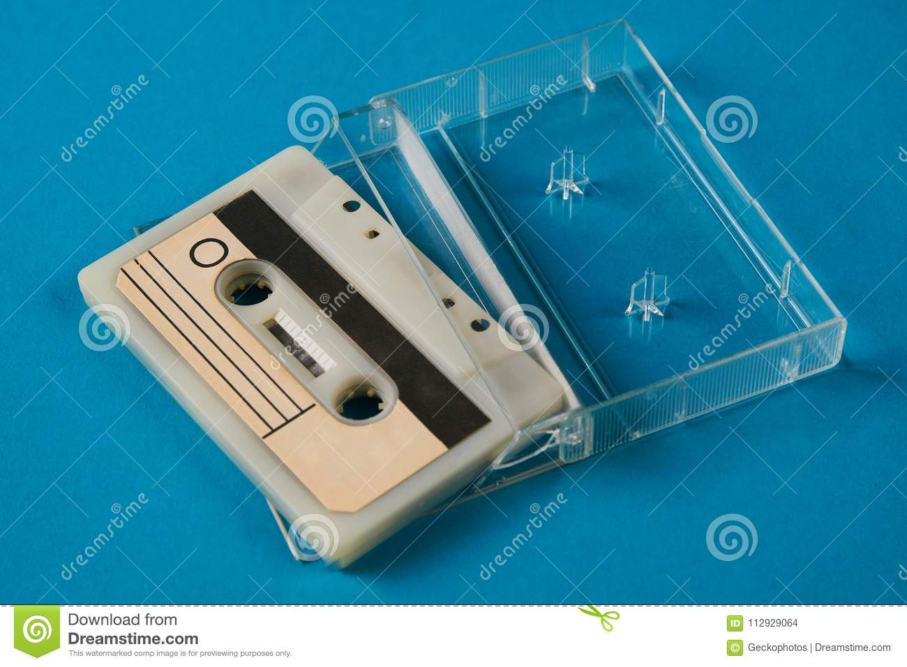 blank cassette tape box with retro cassette on blue background stock