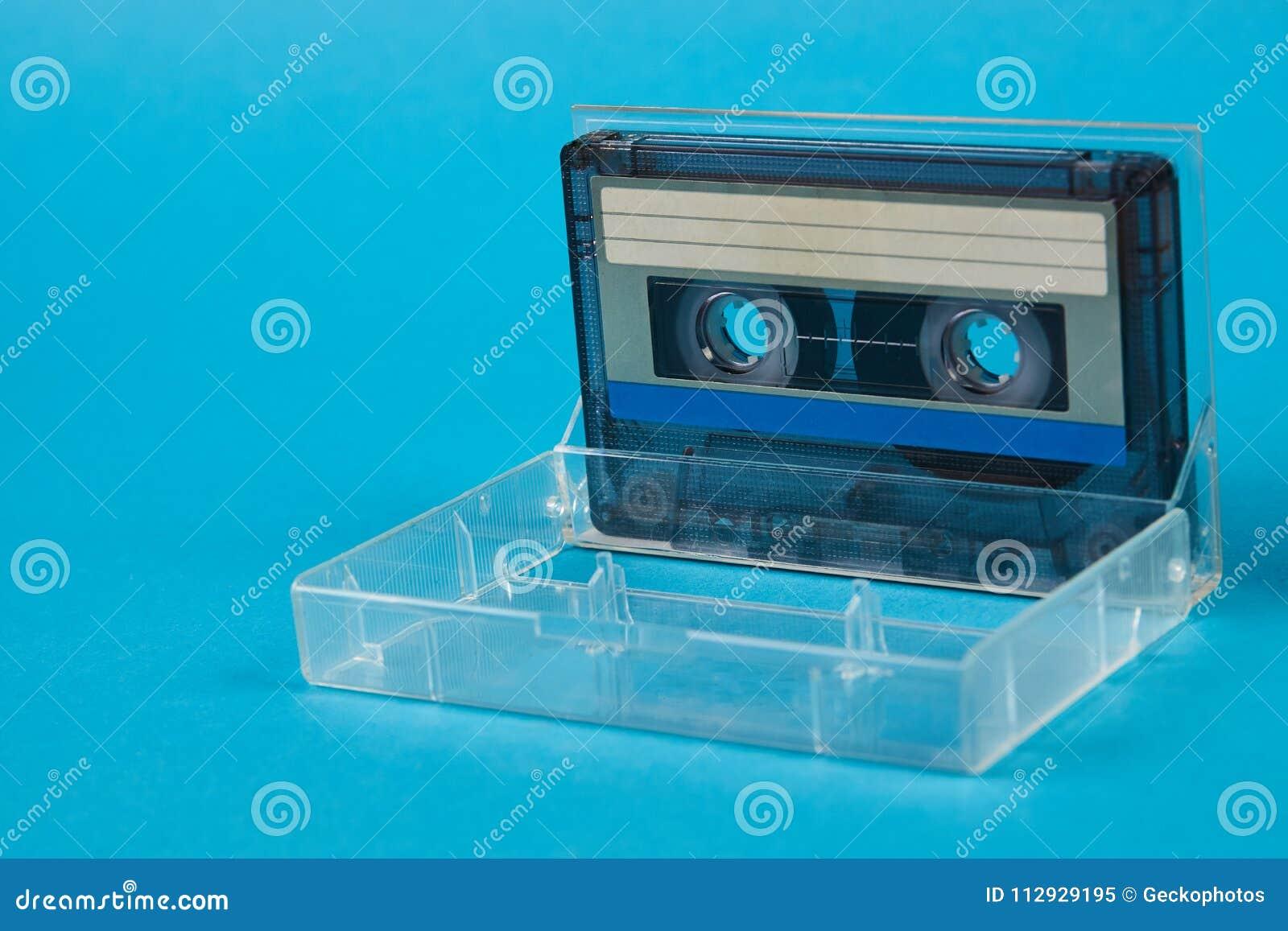blank cassette tape box with retro cassette on blue. Black Bedroom Furniture Sets. Home Design Ideas