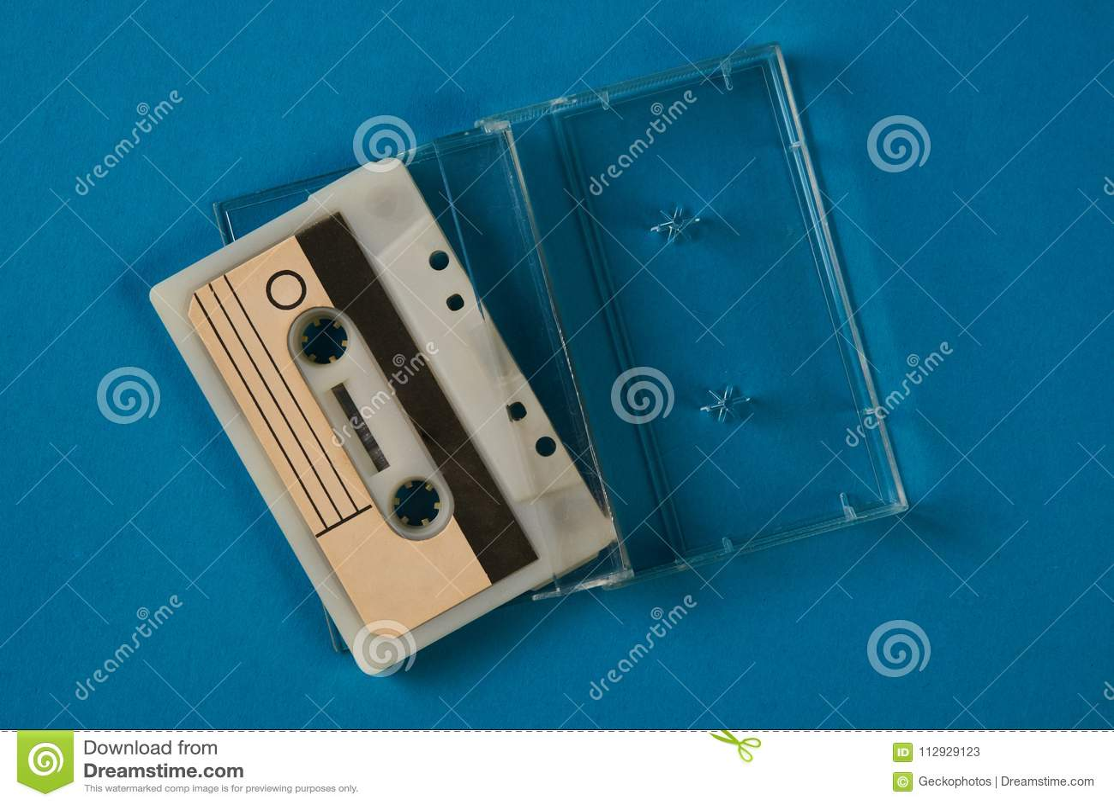 Blank Cassette Tape Box With Retro Cassette On Blue