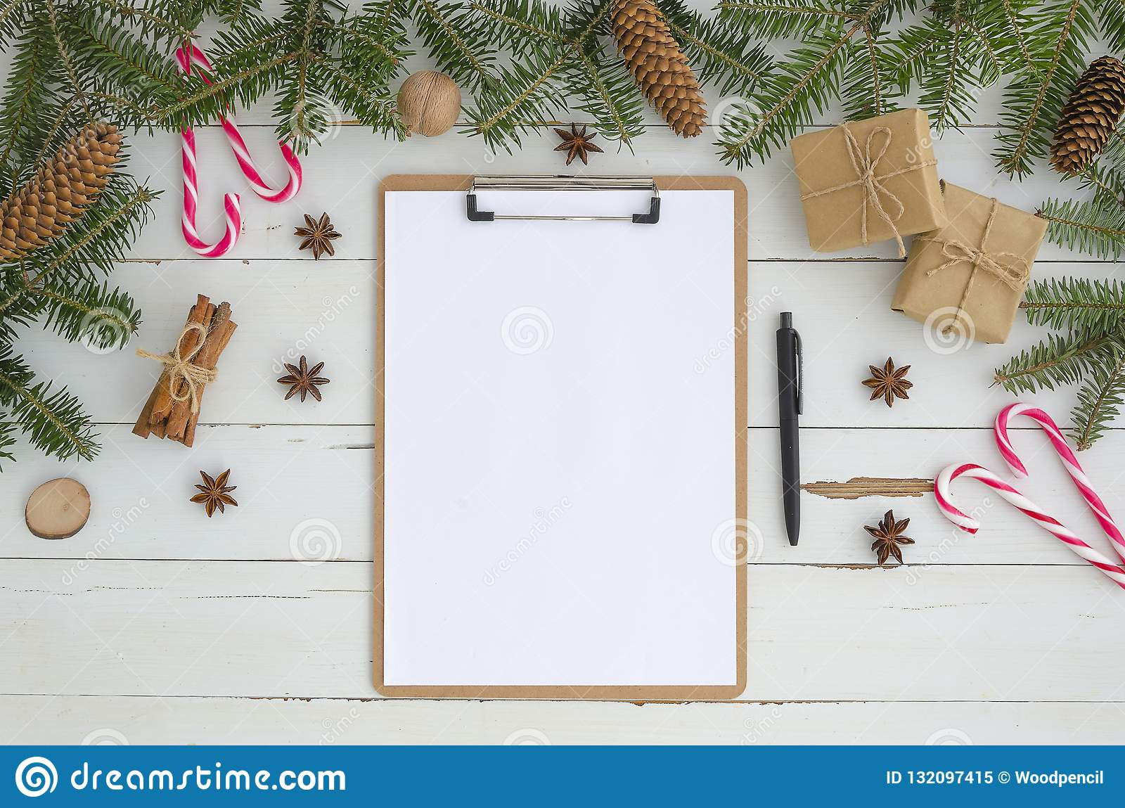 Blank Clipboard And Christmas Decoration On White Wooden Background