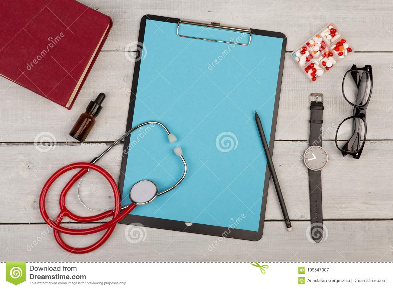 Blank Clipboard, Pills, Book, Stethoscope, Eyeglasses And Watch On ...
