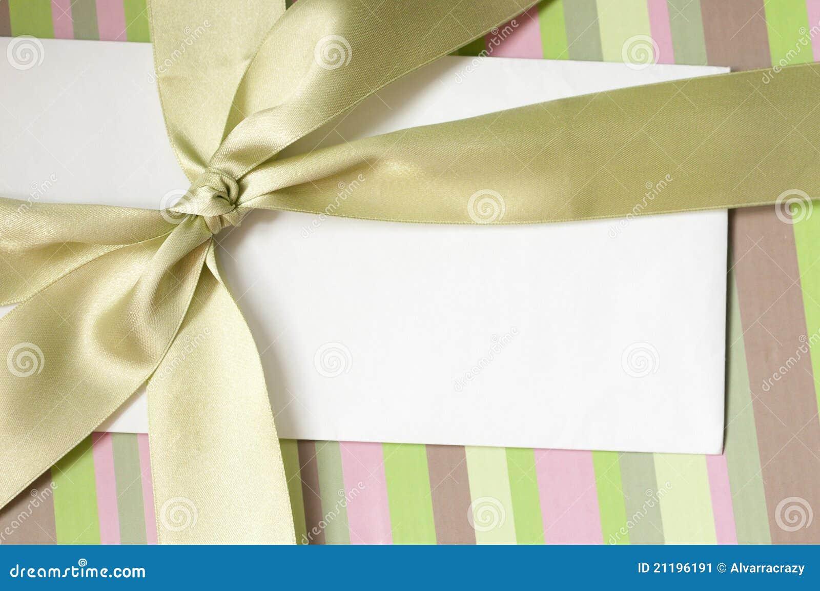 Blank envelope on the gift box