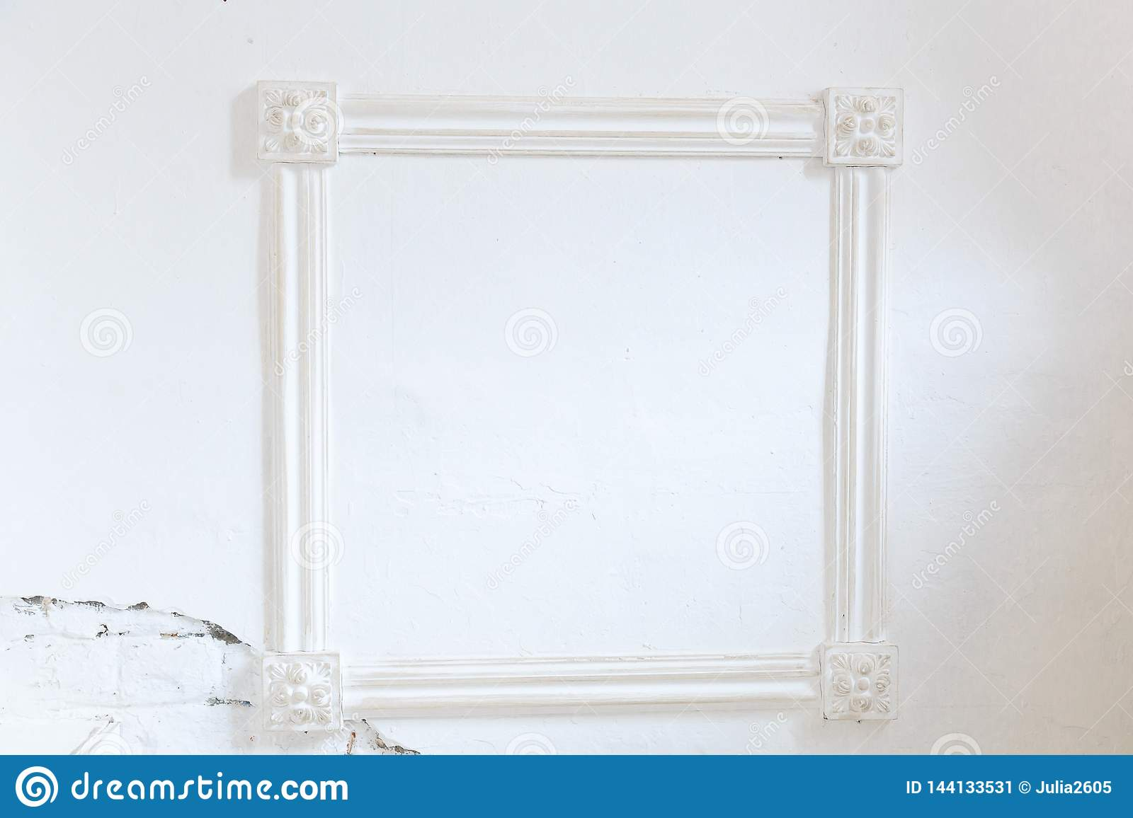 Blank frame on white wall.