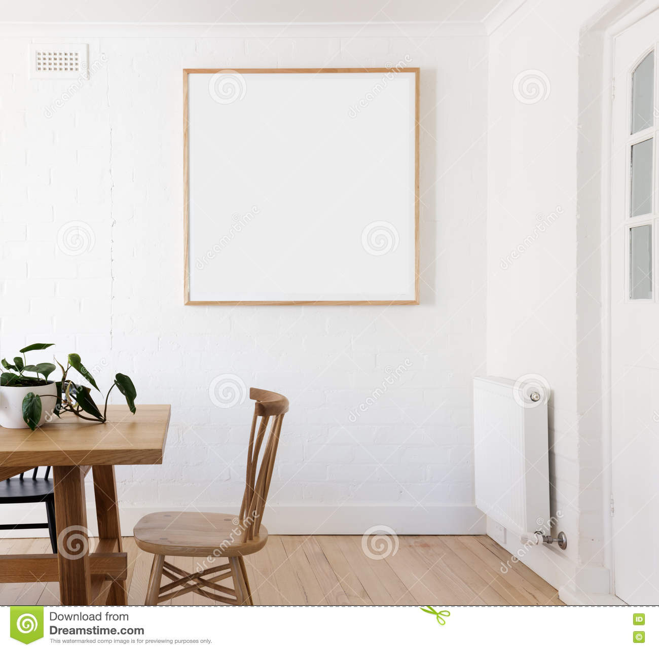 Blank framed print on white wall in danish styled interior for Framed prints for dining room