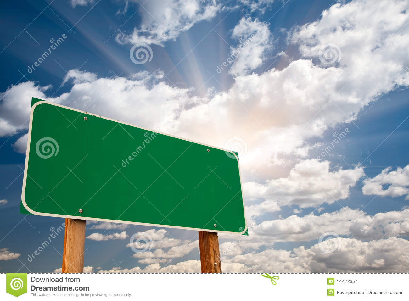 blank green road sign over clouds and sunburst royalty