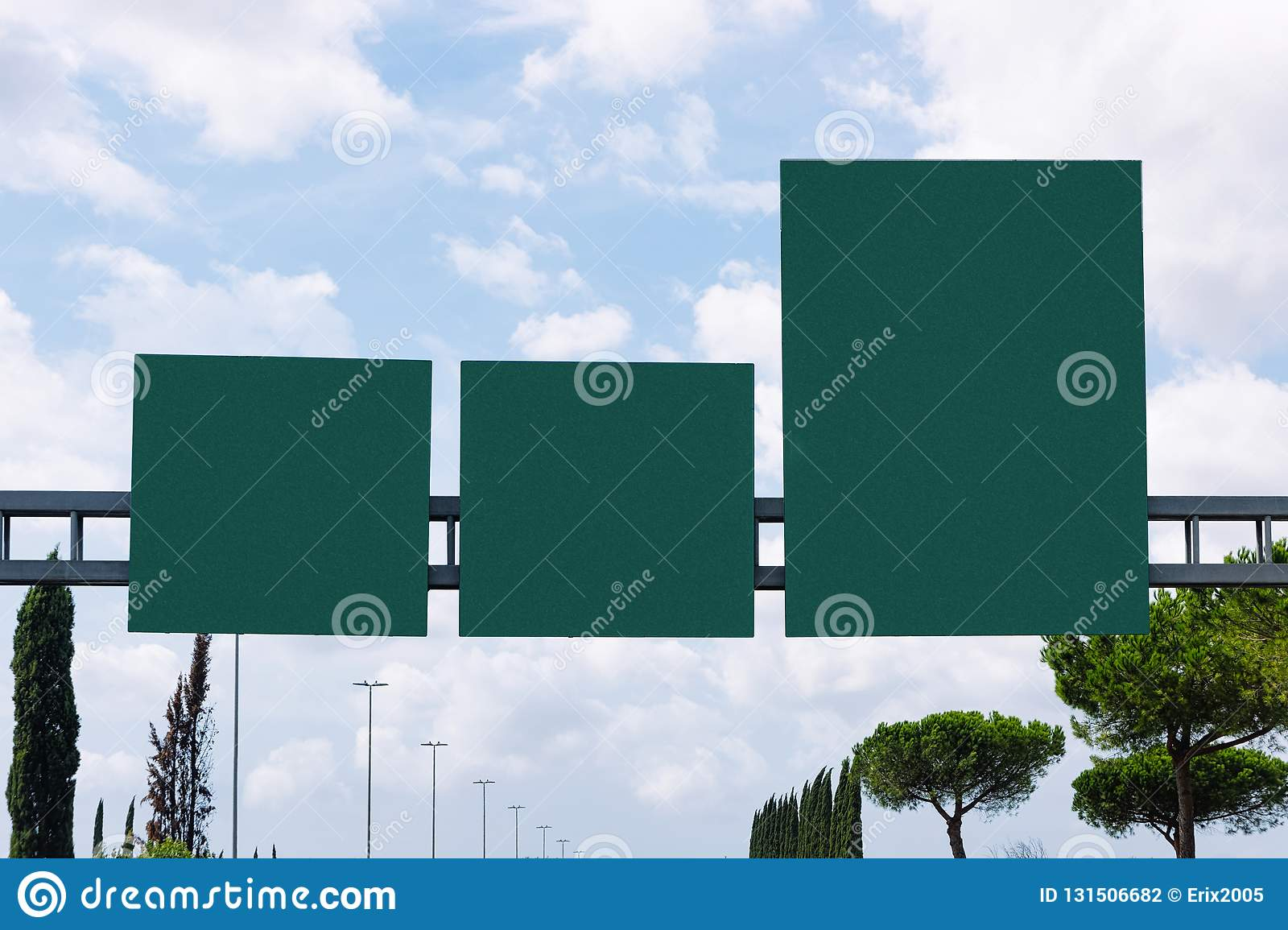 Blank green traffic signs on the road