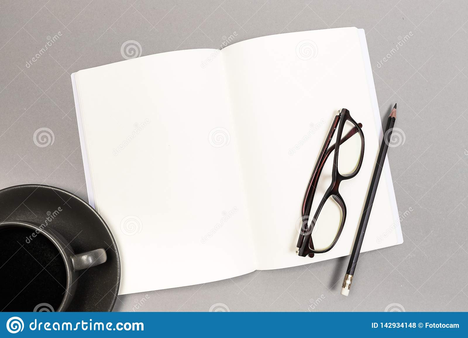 Blank Hard Cover Of Magazine, Book, Booklet, Brochure with coffee cup pencil and glasses. Mock Up Template Ready For Your Design