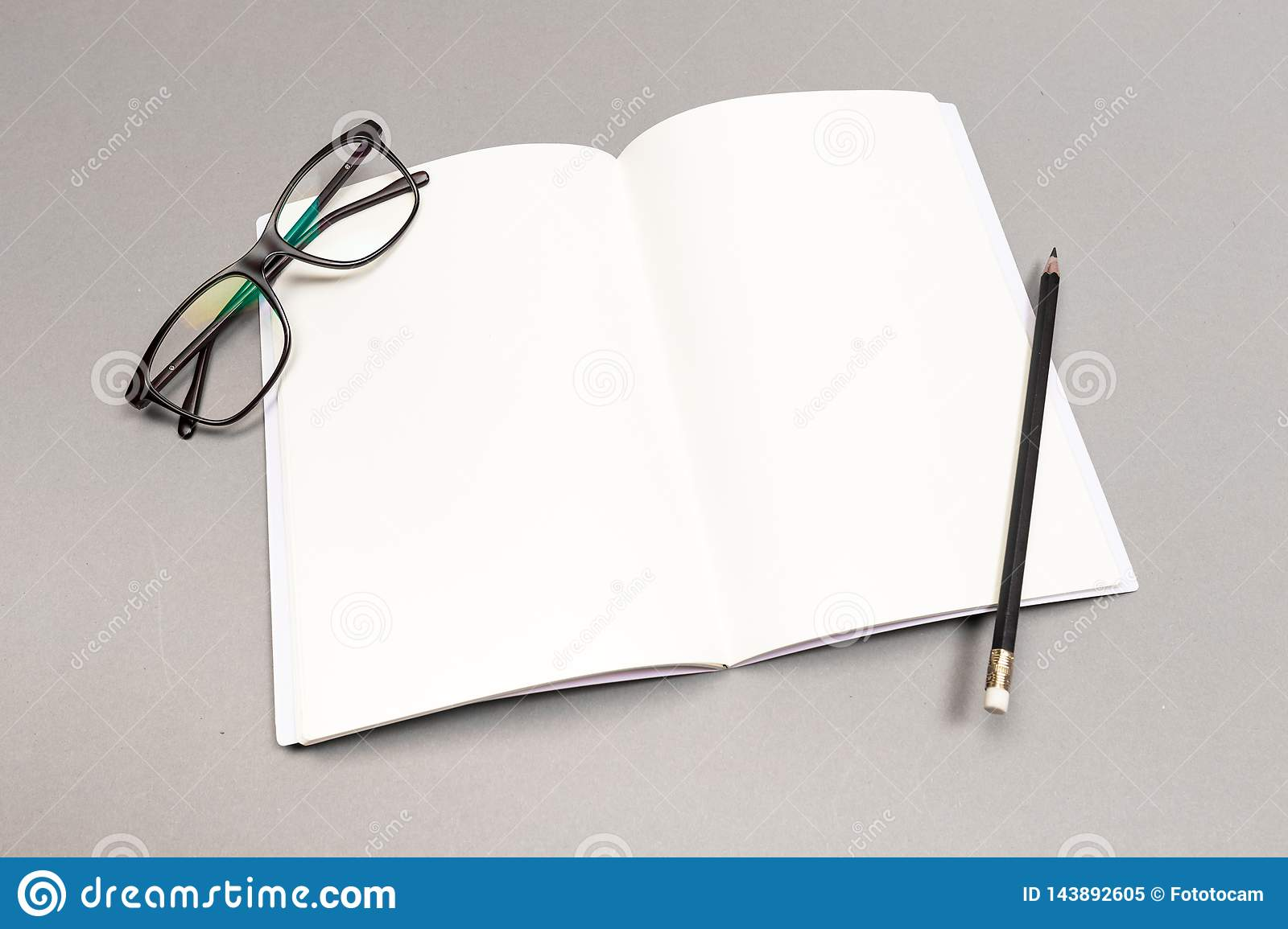 Blank Hard Cover Of Magazine, Book, Booklet, Brochure with pencil and glasses. Mock Up Template Ready For Your Design