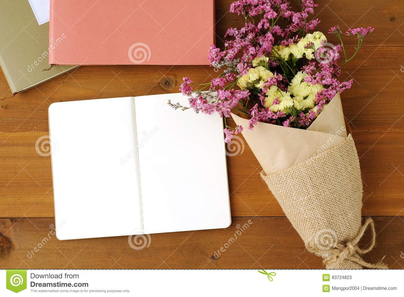 Blank Note Book Paper And Flower Bouquet On Wood Background Stock