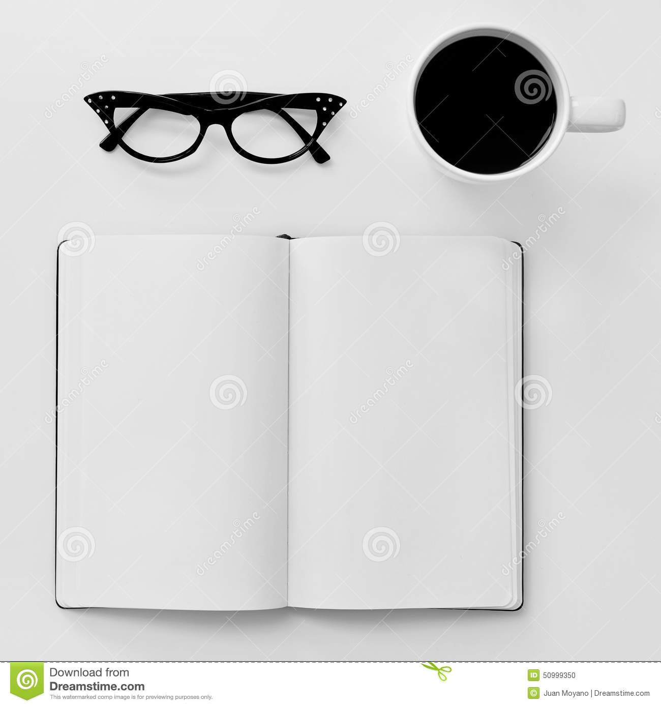 Blank Notebook, Eyeglasses And Cup Of Coffee On A White