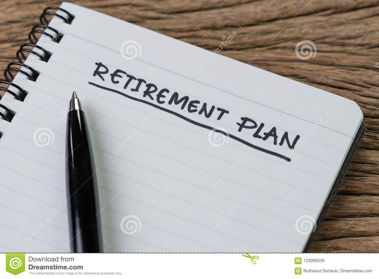 Blank notepad with pen and handwriting important headline as Retirement Plan on wood table, planning for saving and investment