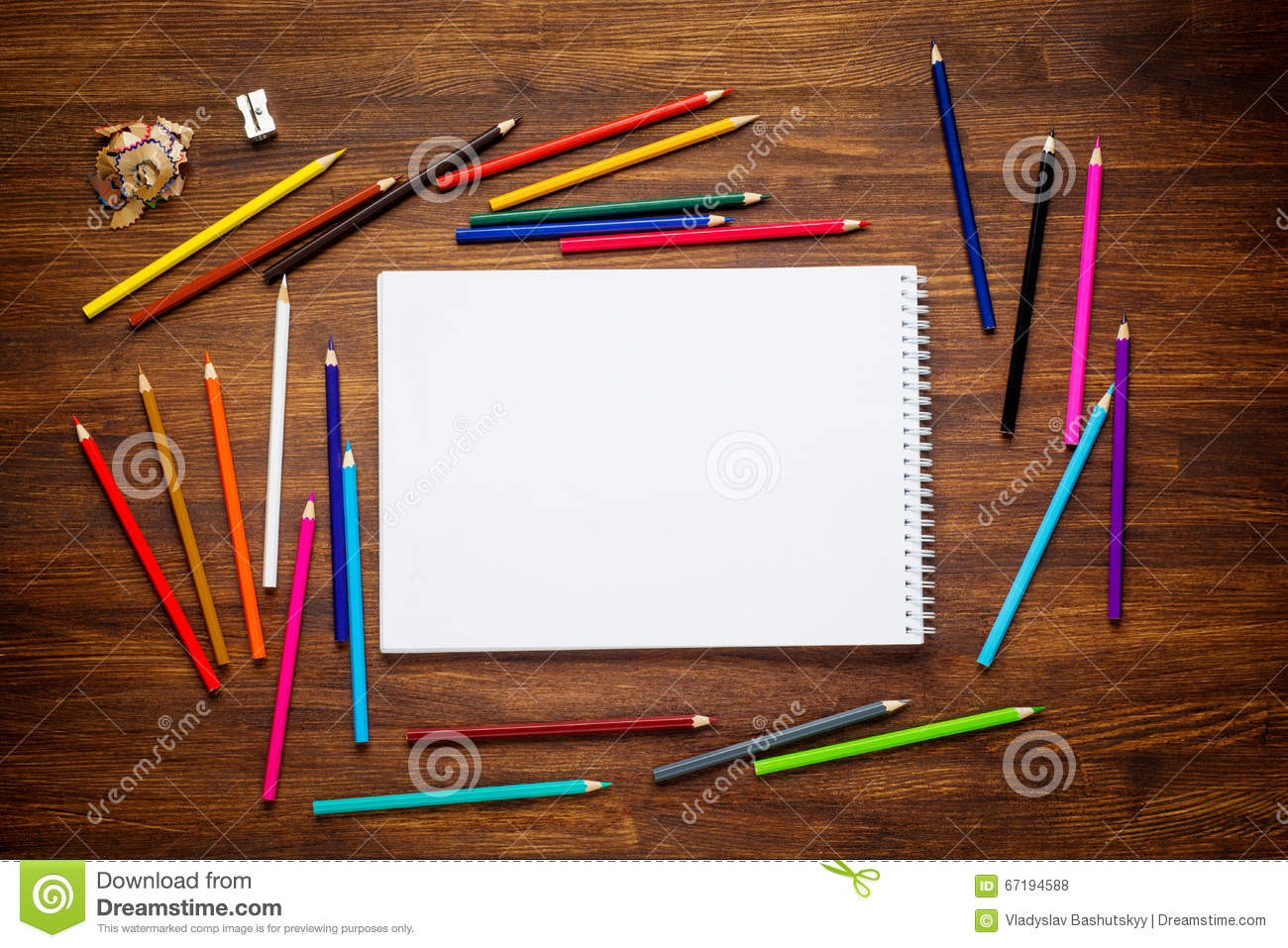 Colorful pencils on wooden table top view royalty free