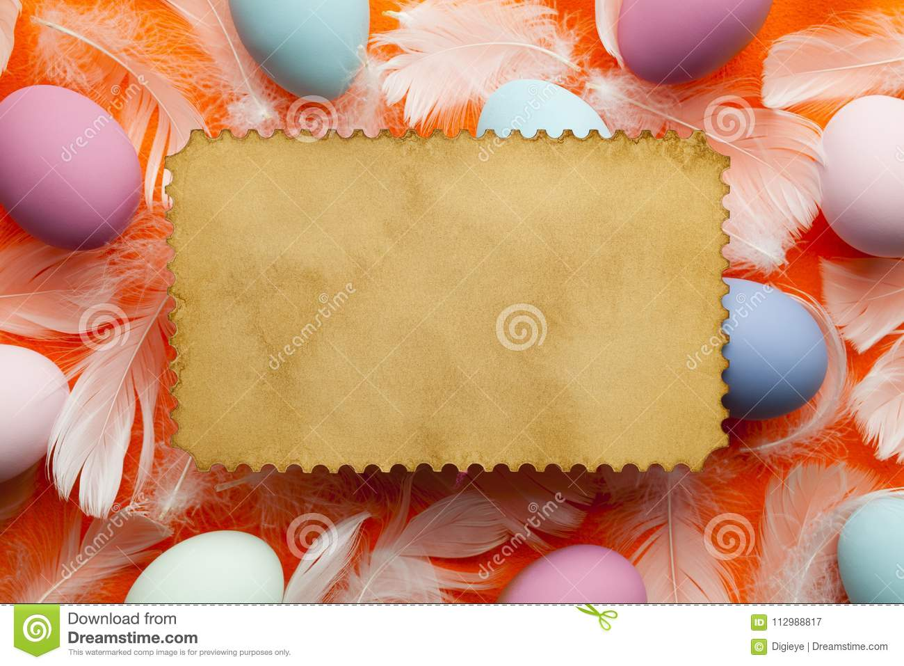 Blank paper label, colored Easter eggs and white feathers