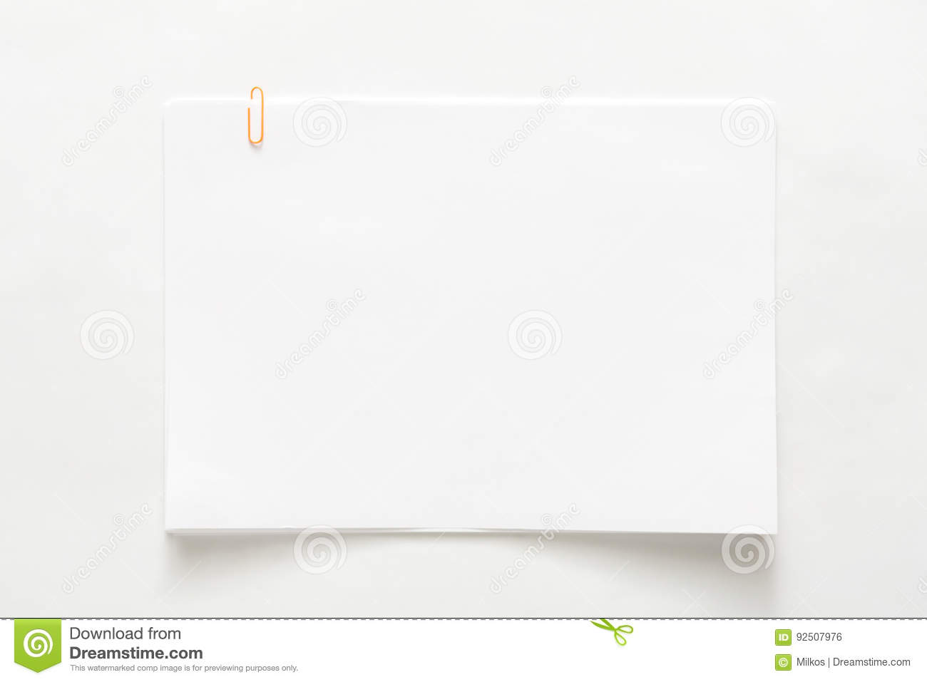 Blank paper sheet attached with clip isolated on white background