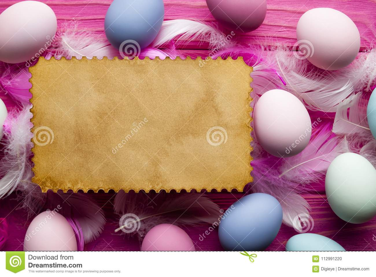 Blank paper sheet, colored Easter eggs and feathers