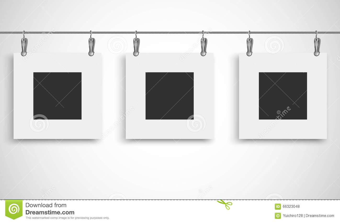 Hanging Photos On Wire blank picture frame hanging on a wire rope with metallic clip