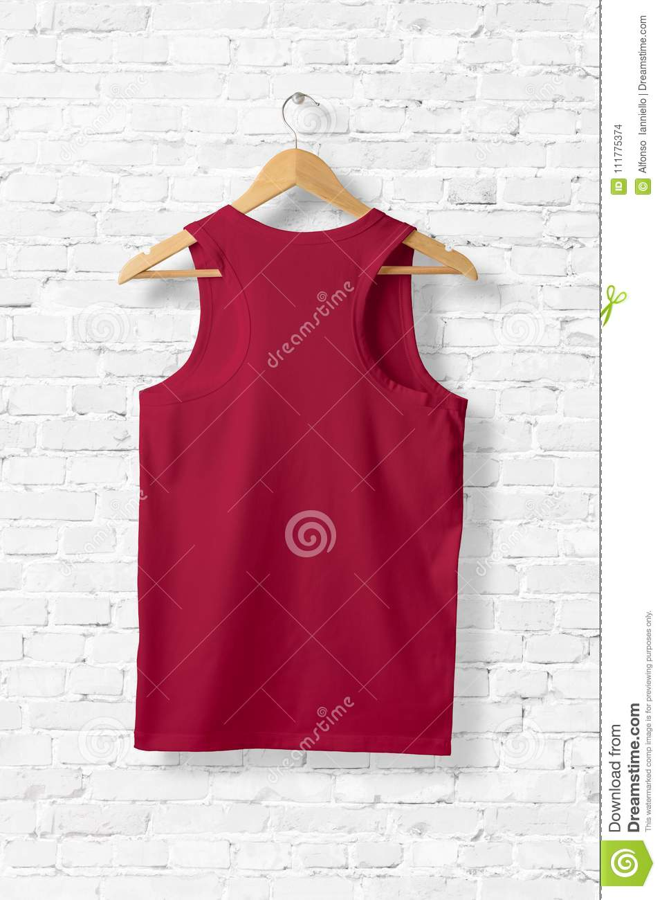 Blank Red Tank Top Mock-up hanging on white wall.