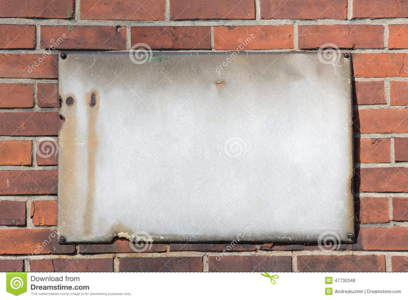 blank retro rusty metal sign on brick wall stock photo