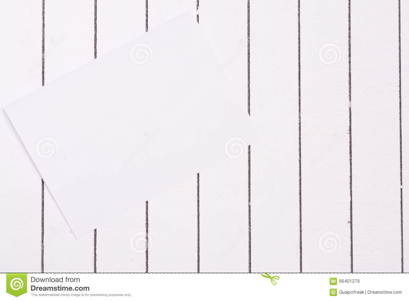 blank sheet of paper against a background white wood stock