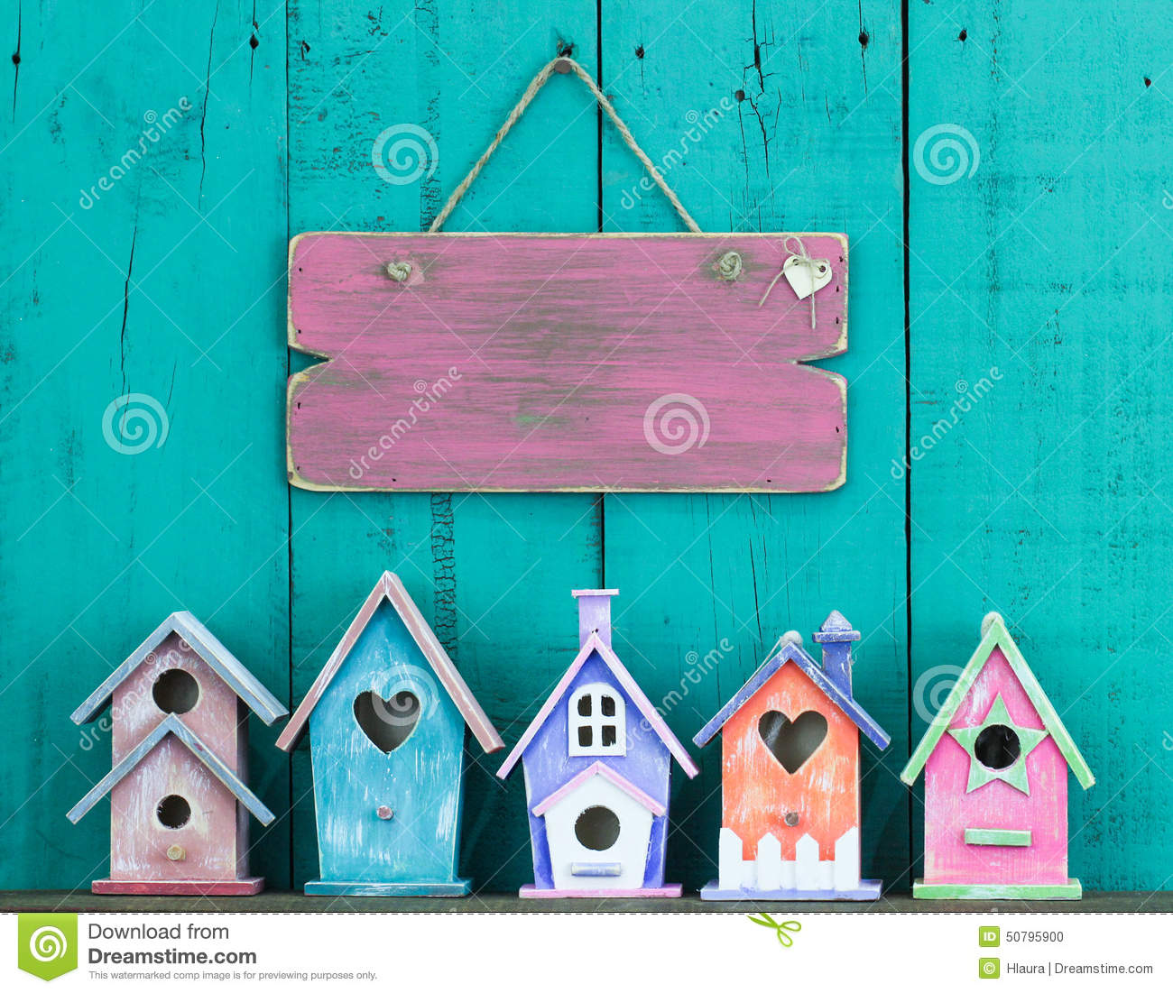 Blank Sign Hanging On Fence By Row Of Birdhouses Stock