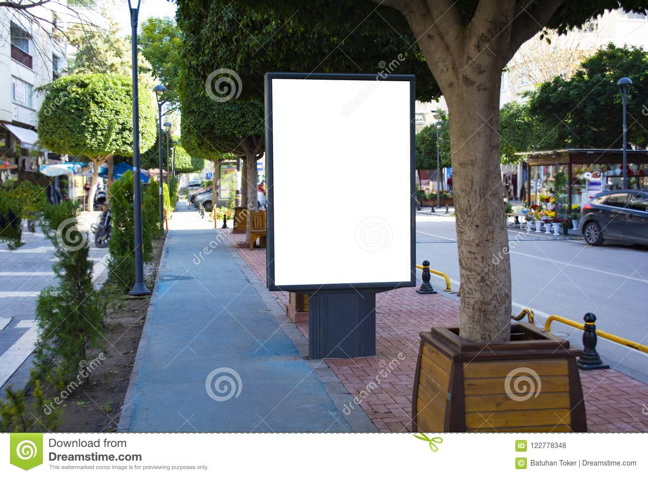 Blank vertical street billboard stand with city background. Blank street billboard poster stand on city background. 3d illustratio