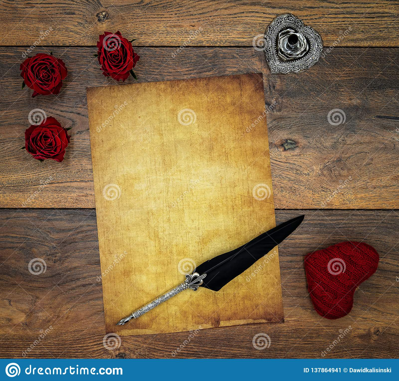 Blank vintage card with red cuddle hart, red roses, ink and quill on vintage oak, love letter on antique oak - top view