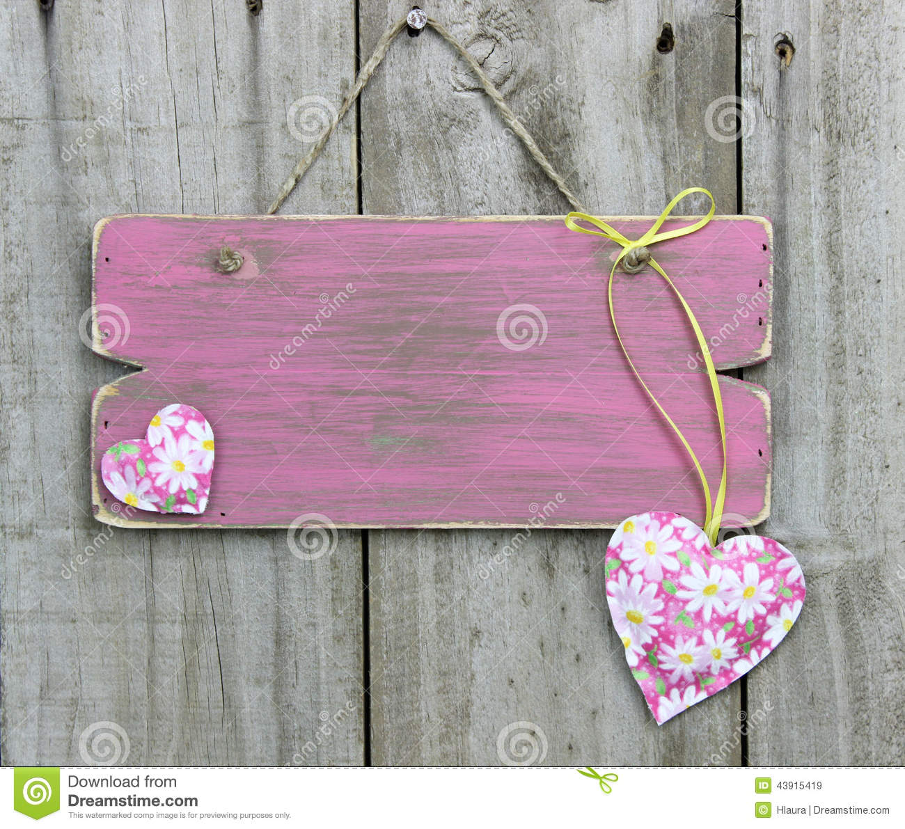 Blank Weathered Pink Sign With Flower Hearts Hanging On
