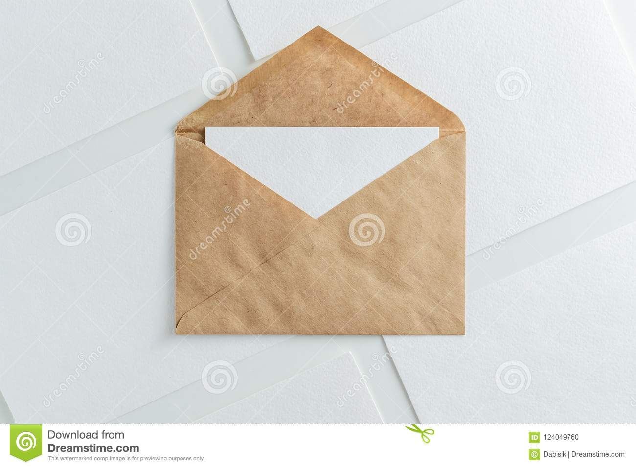 Blank white card in kraft brown envelope and paper sheets template mock up