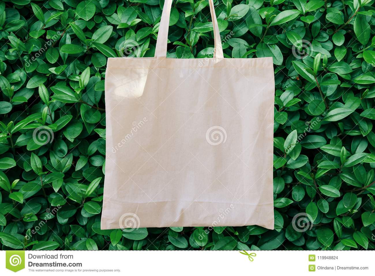 Mockup Linen Cotton Tote Bag on Green Bush Trees Foliage Background. Eco Nature Friendly. Environmental Conservation Recycling